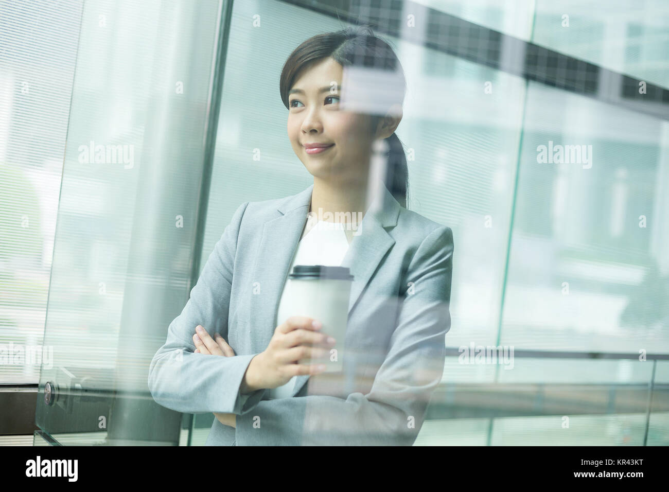 Asian businesswoman inside office - Stock Image