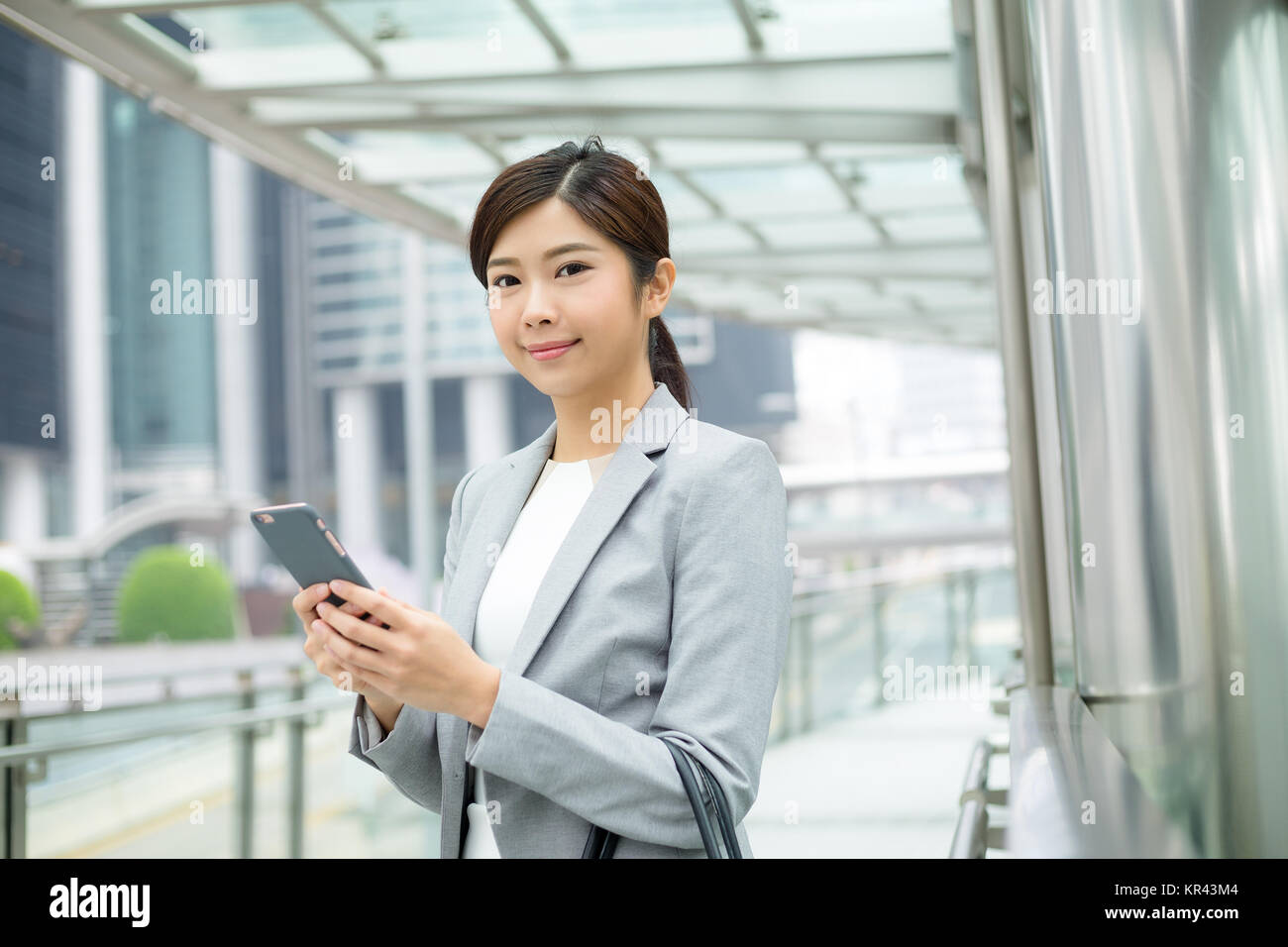 Business woman read on mobile phone - Stock Image
