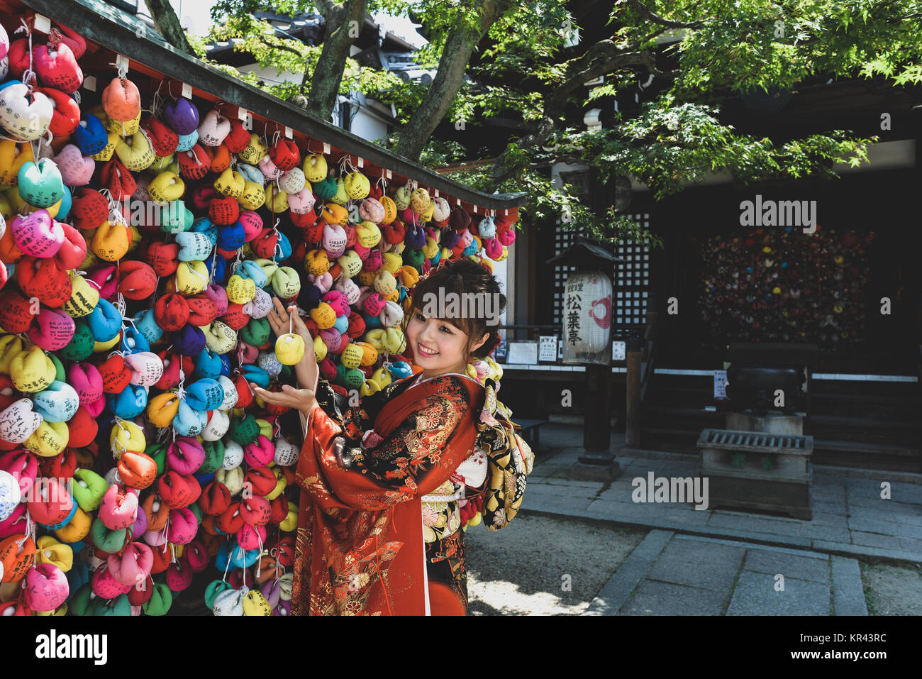 Japanese lady at a shrine - Kyoto - Stock Image