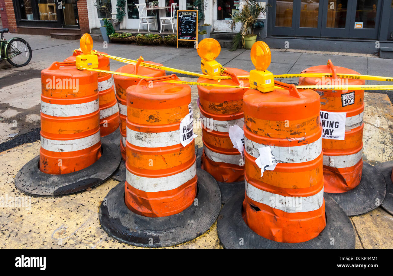 Large traffic cones on a street in New York City - Stock Image