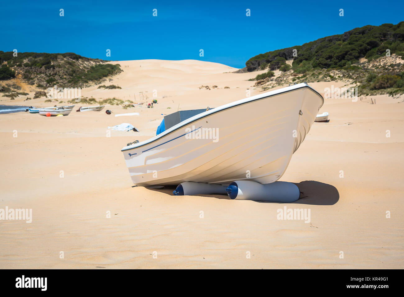 boat at bolonia beach a coastal village in the municipality of Tarifa in the Province of Cadiz in southern Spain. Stock Photo