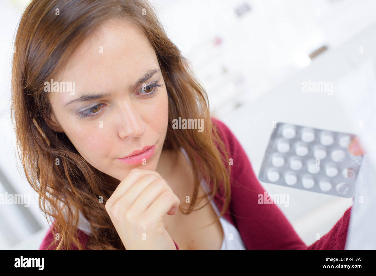 Woman taking a tablet - Stock Image