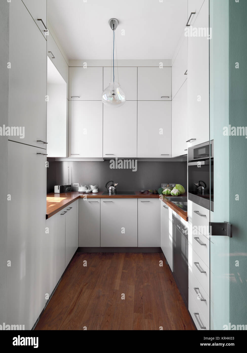 vertical view of a modern kitchen Stock Photo - Alamy