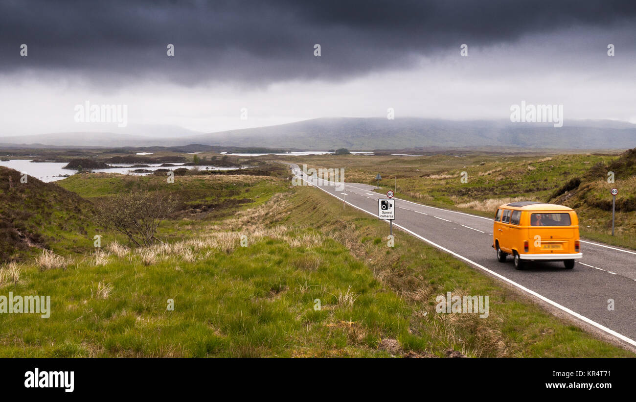 Glencoe, Scotland, UK - June 4, 2011: A traditional VW Camper Van is among traffic crossing the bleak Rannoch Moor - Stock Image