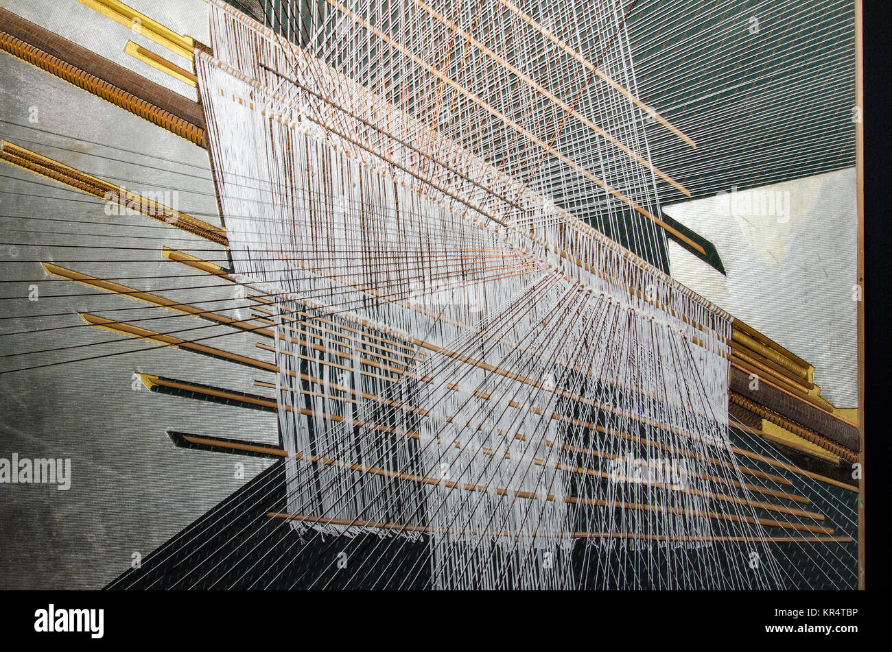 Silk fabric, hand weaving process in Thailand - Stock Image