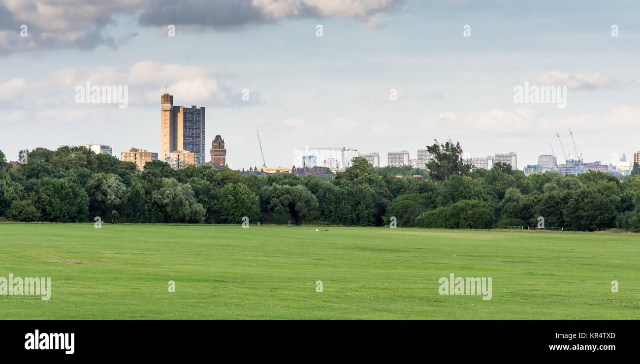 London, England - July 10, 2016: The brutalist Trellick Tower high-rise council housing block and the skyline of - Stock Image