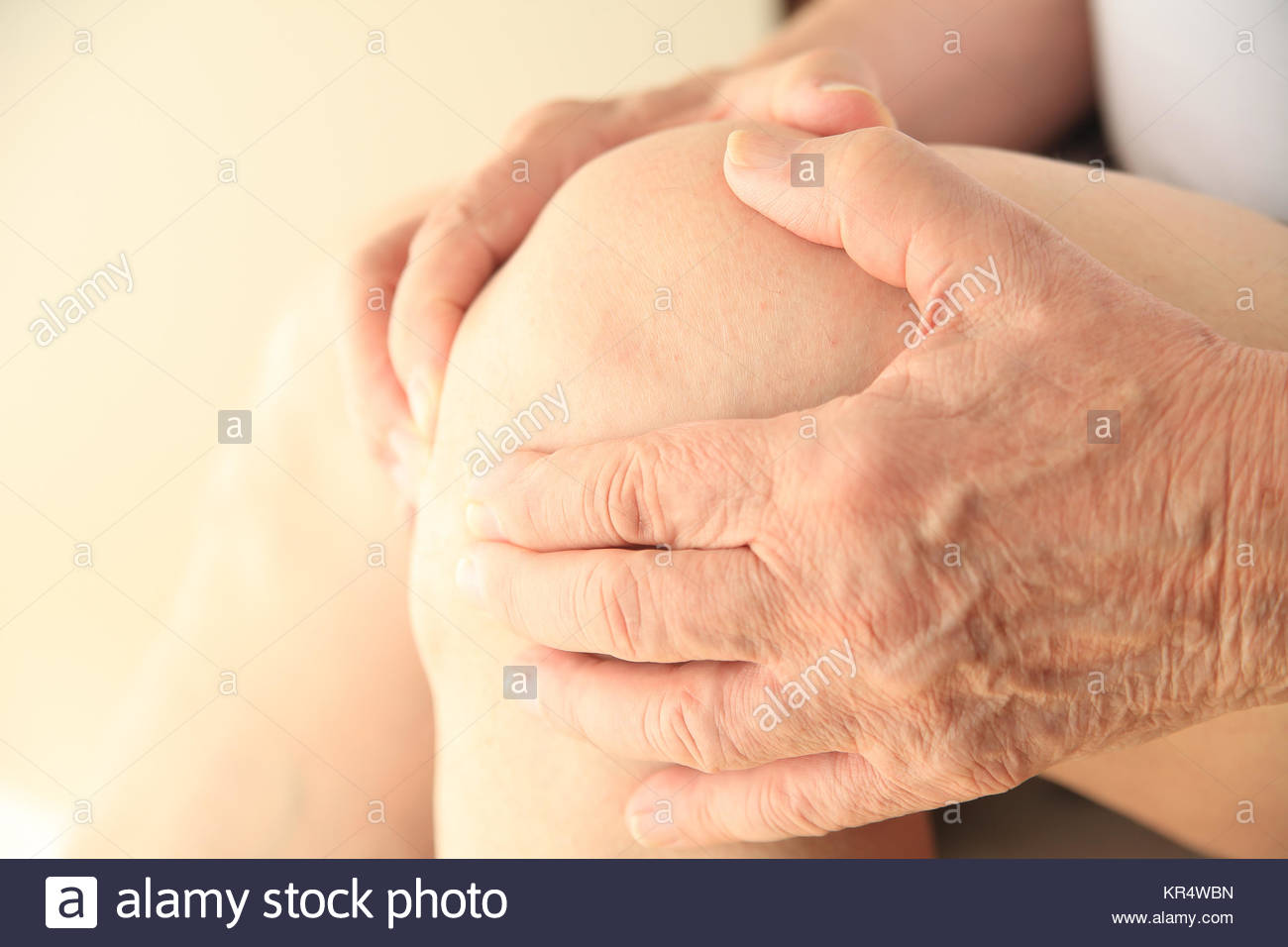 Closeup of senior man with soreness in knee - Stock Image