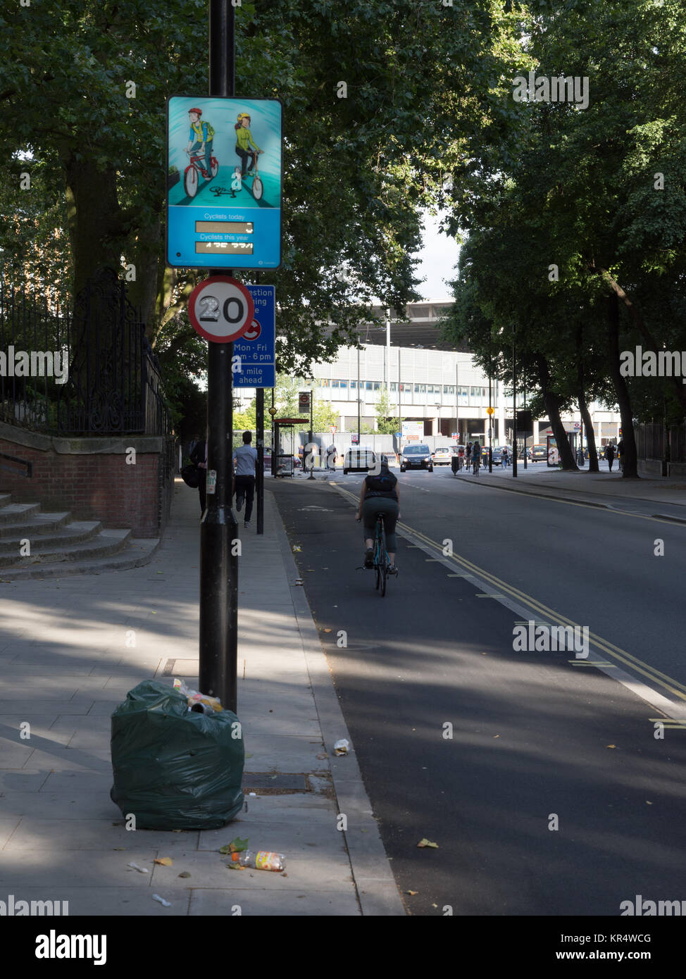 London, England - July 25, 2016: Cyclists use the newly introduced 'segregated' stepped cycle lanes on Pancras - Stock Image
