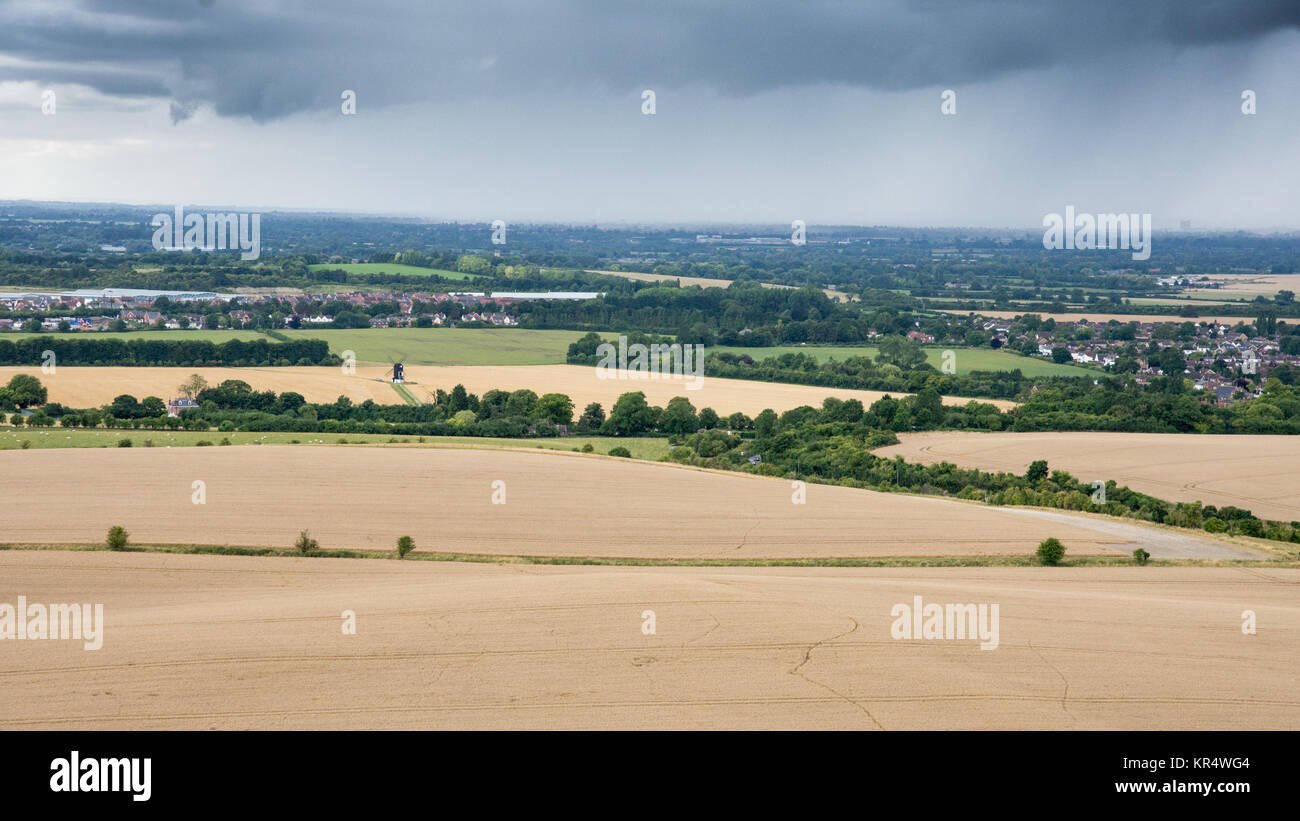 A downpour of rain shrouds villages in the agricultural landscape of Aylesbury Vale in Buckinghamshire, England, - Stock Image