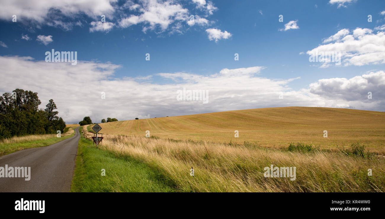 Pasture fields cover the rolling hills of England's Midlands at Transor Wold near Oundle in Northamptonshire. - Stock Image
