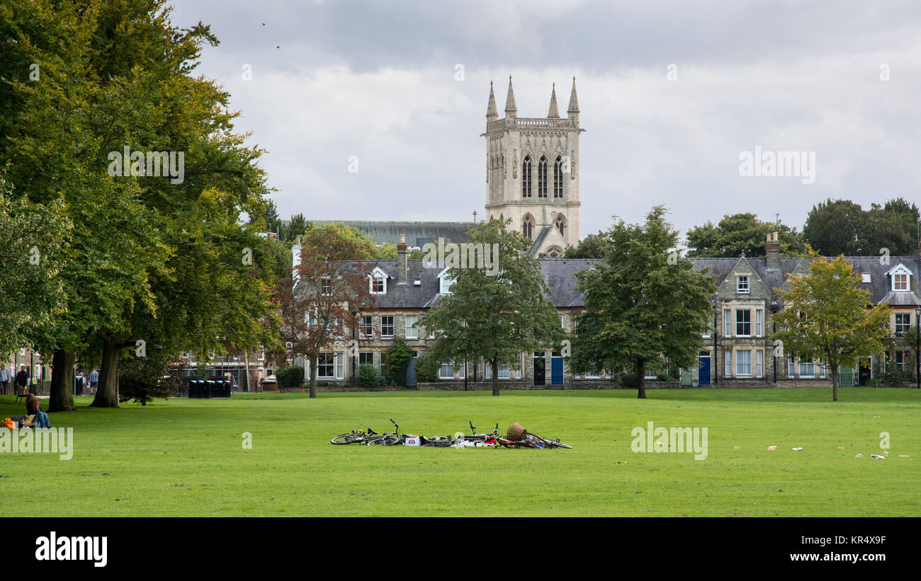Cambridge, England, UK - August 19, 2017: Students' bicycles are left in a pile in Jesus Green park on a summer - Stock Image