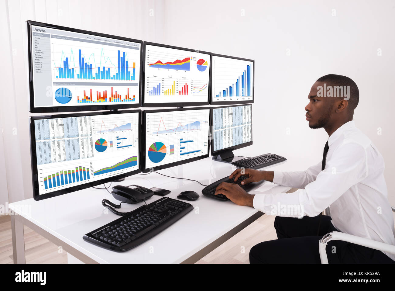 Businessman Analyzing Financial Chart On Computer - Stock Image