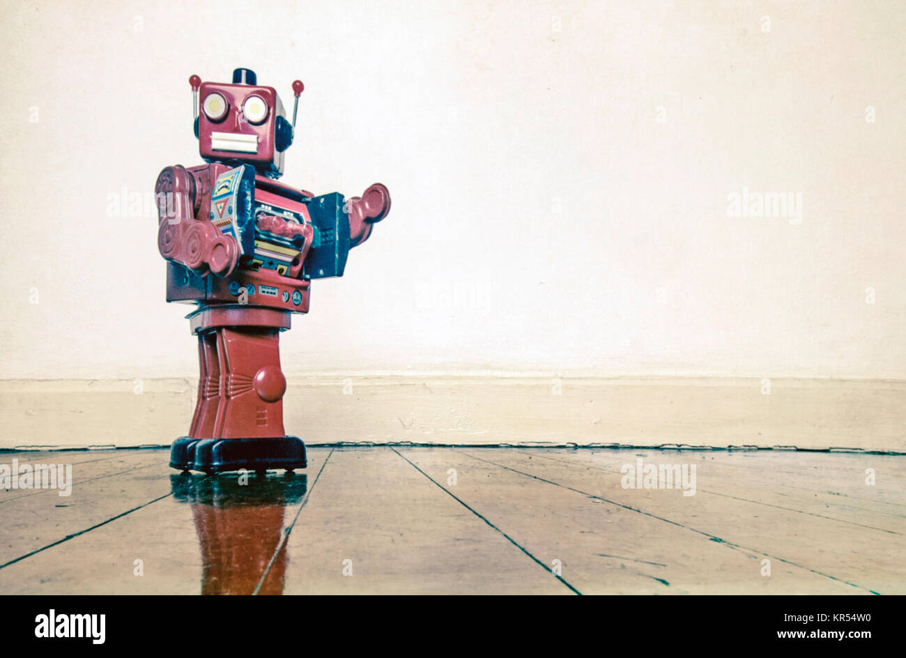 got to go retro red robot on old woden floor with reflection - Stock Image