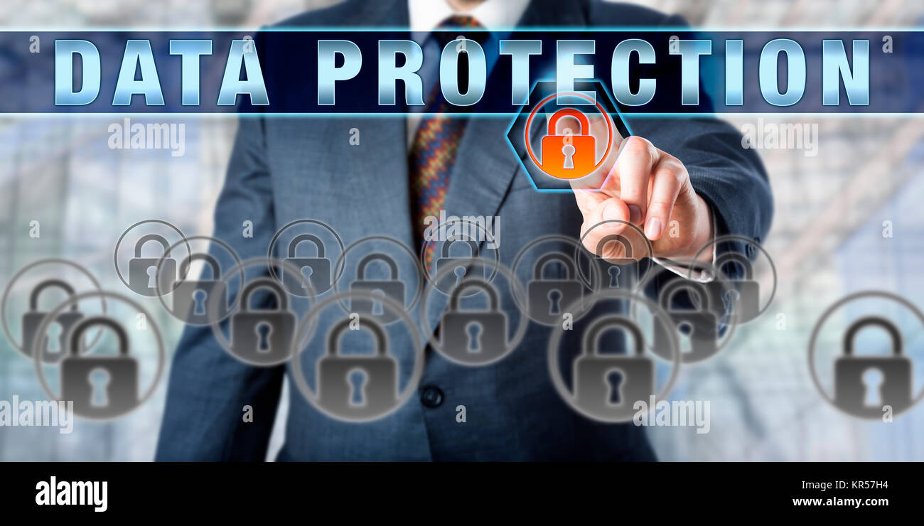 Businessman Pressing DATA PROTECTION - Stock Image