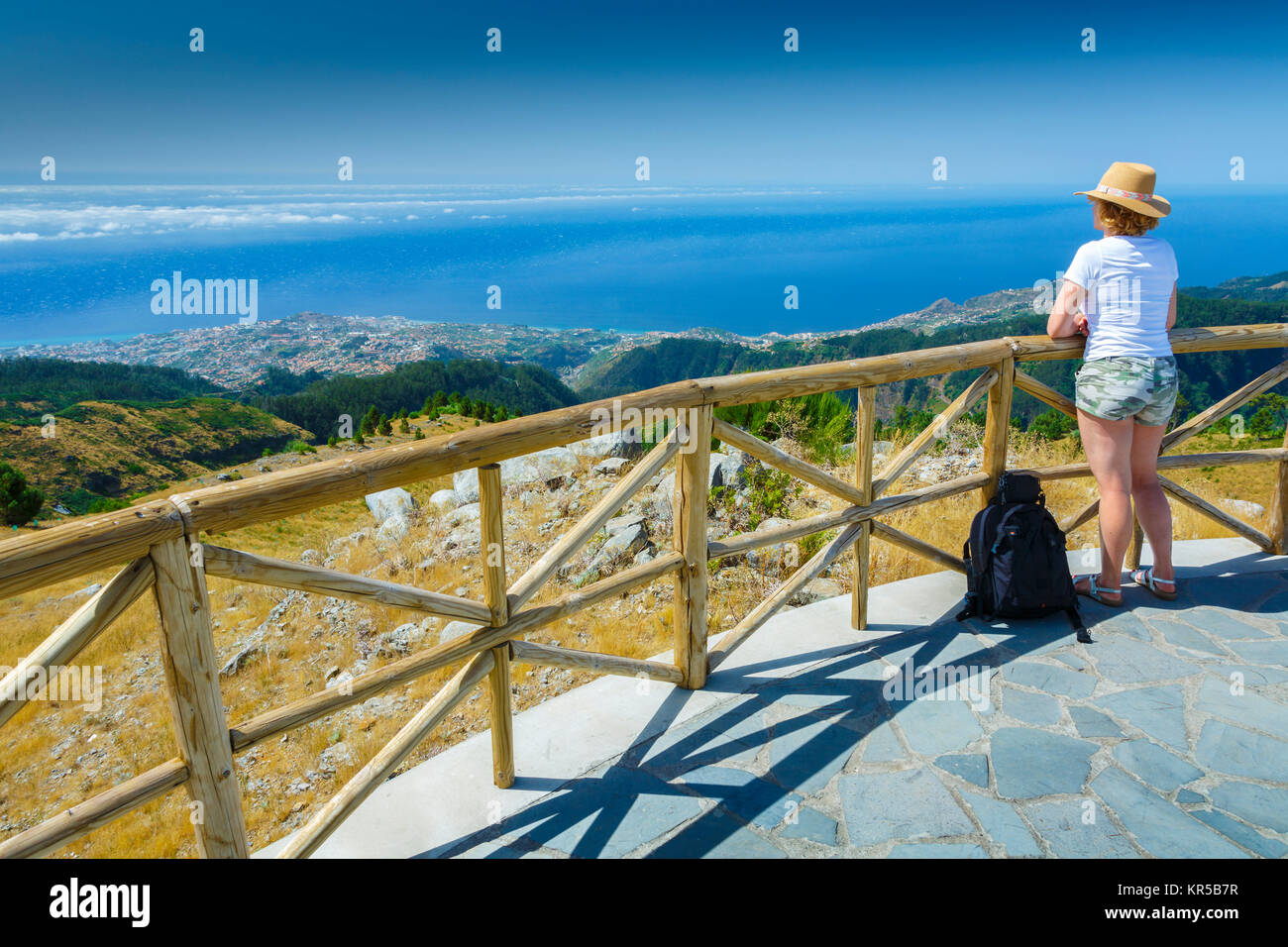 Woman in a viewpoint. Paredao viewpoint. Madeira, Portugal, Europe. - Stock Image