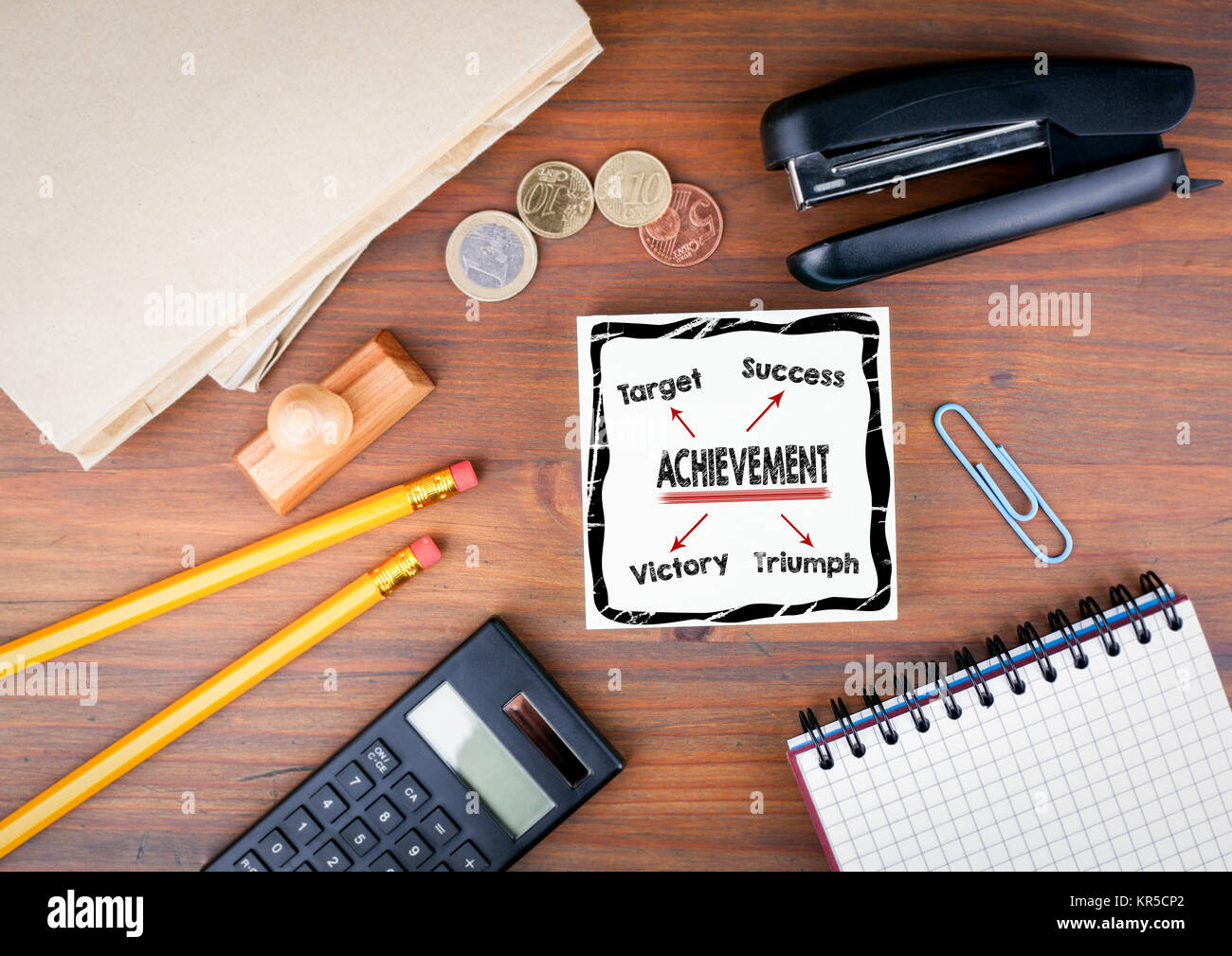 achievement concept. Office desk with stationery, chart and communication background - Stock Image