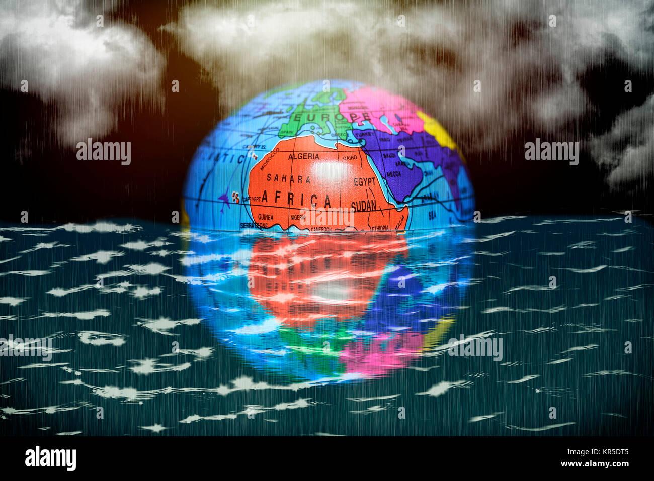 Earth globe in the water, symbolic photo climate change, Erdglobus im Wasser, Symbolfoto Klimawandel Stock Photo
