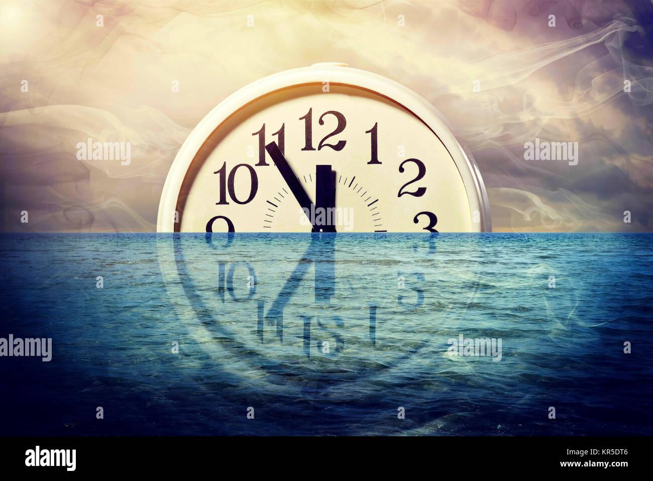 Clock, Five before Twelve, in the water, symbolic photo climate change, Uhr, Fünf vor Zwölf, im Wasser, Symbolfoto Klimawandel Stock Photo