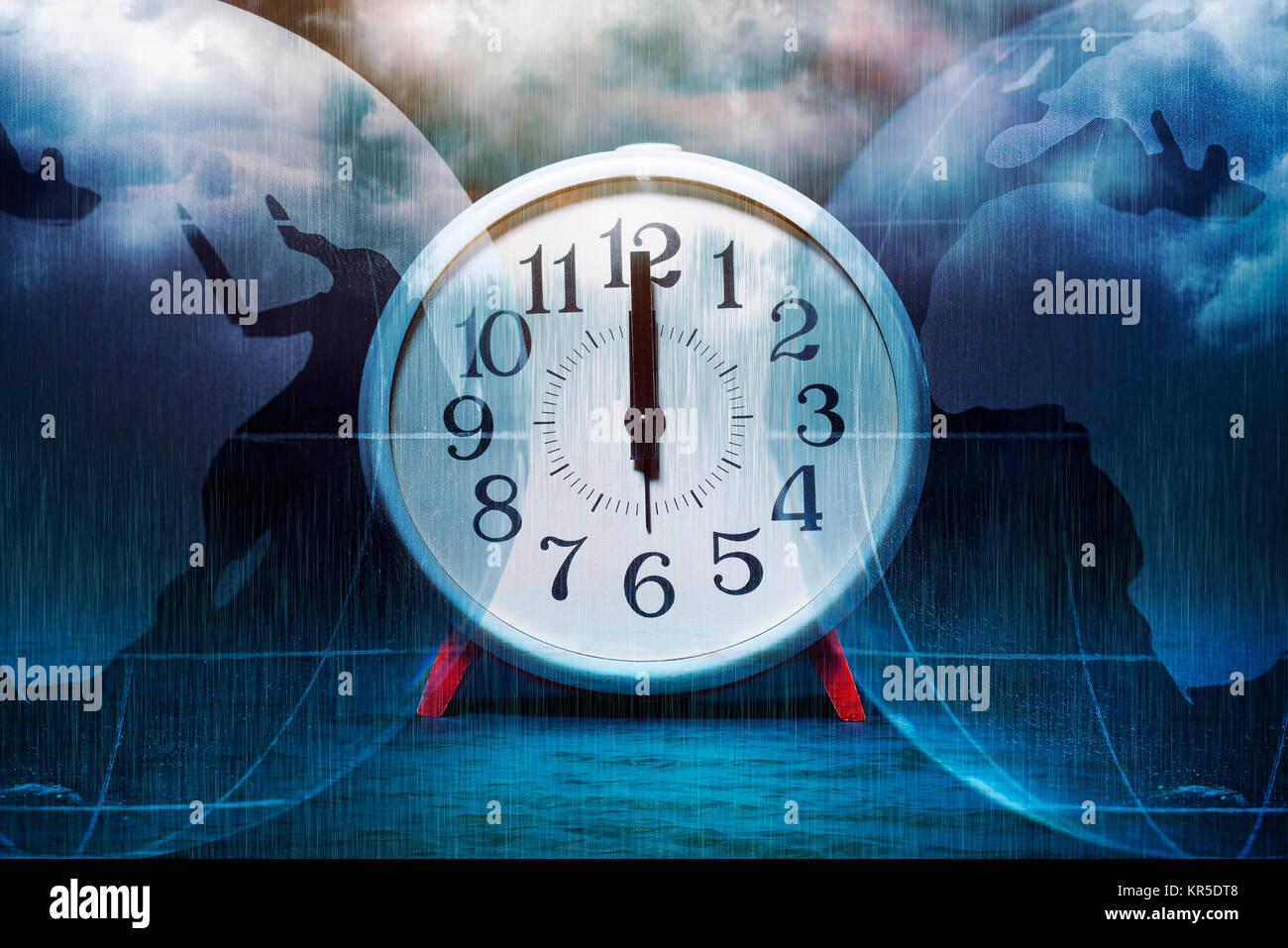 Alarm clock on 12 o'clock and globe, symbolic photo climate change, Wecker auf 12 Uhr und Erdkugel, Symbolfoto Klimawandel Stock Photo