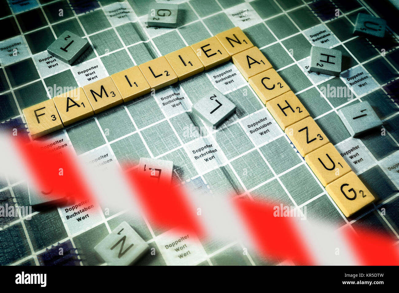 Letters form the words Families and Relief train behind stop tape, symbolic photo put out family relief train, Buchstaben Stock Photo