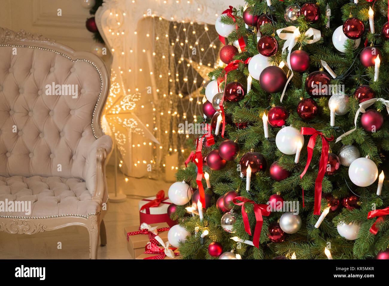 Christmas Living Room With A Fireplace Sofa Tree And Gifts Beautiful New Year Decorated Classic Home Interior Winter Background