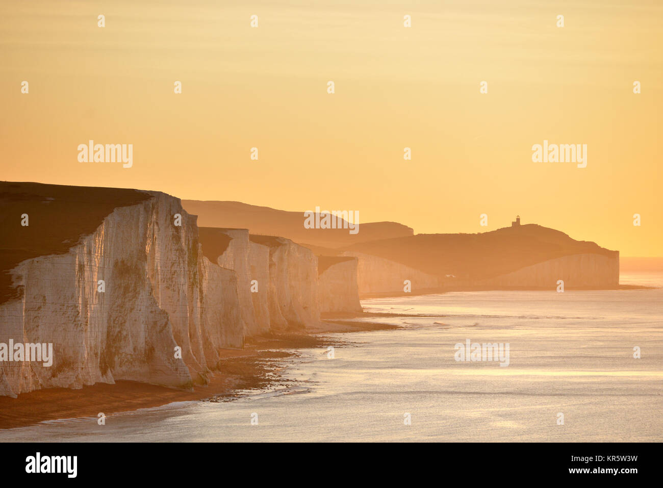 Cuckmere Haven, East Sussex. 18th December 2017. The morning sun illuminating the iconic Seven Sisters chalk cliffs - Stock Image