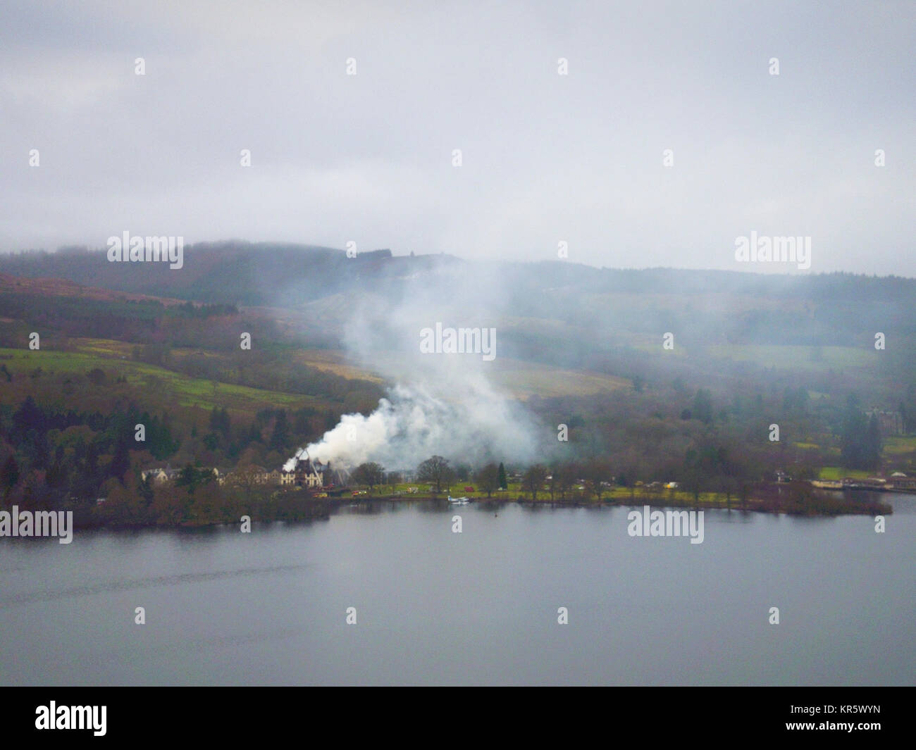Balloch, Loch Lomond UK 18 December 2017. The 5 star Cameron House Hotel continues to smoulder 6 hours after fire - Stock Image
