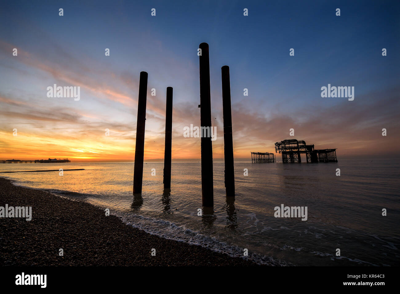 Brighton, UK. 19th Dec, 2017. A beautiful sunrise along Brighton seafront by the West Pier on a calm sunny morning - Stock Image