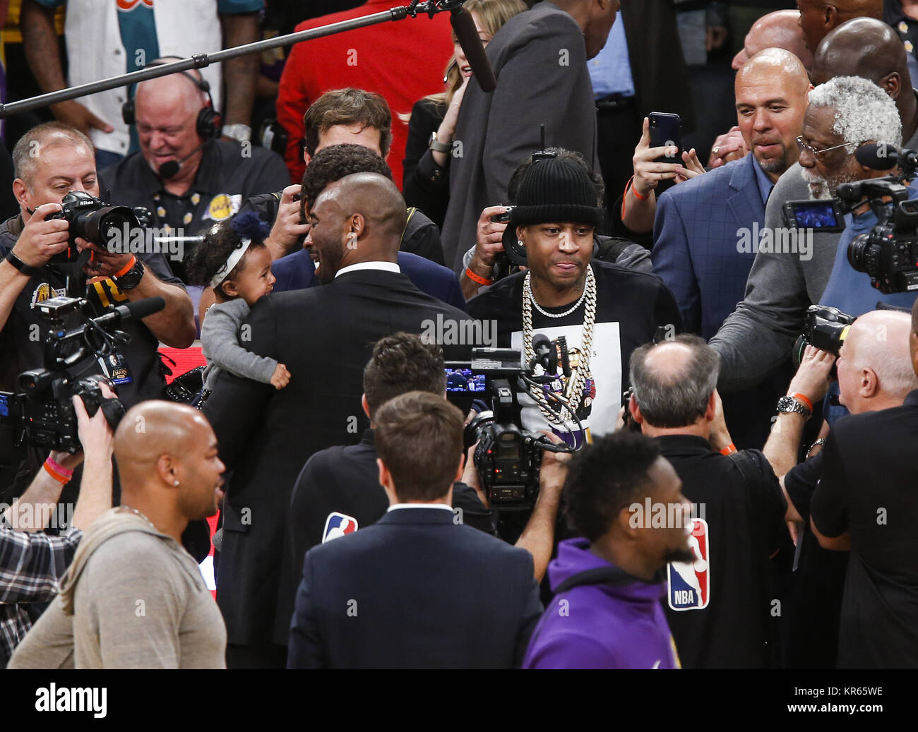 5770f6466e9 Allen Iverson and Kobe Bryant greet after his  8 and  24 jerseys retirement  ceremony during a basketball game between the Los Angeles Lakers and the ...