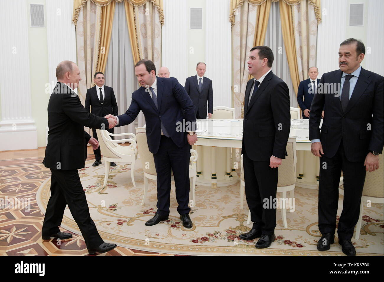 MOSCOW, RUSSIA - DECEMBER 19, 2017: Russia's president Vladimir Putin shakes hands with the director of the - Stock Image
