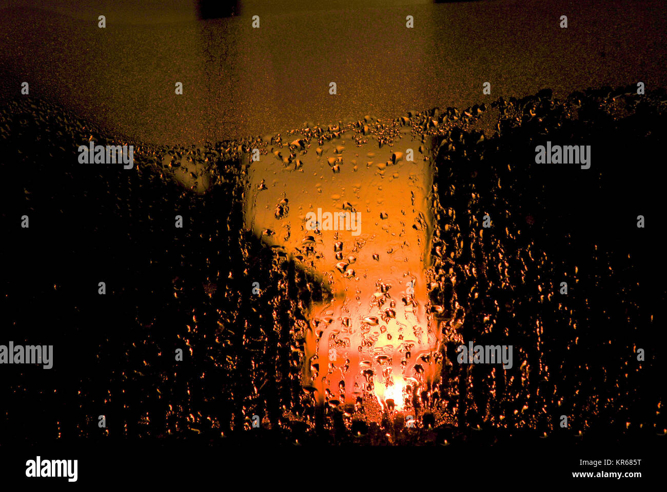 Portland, Dorset. 19th December 2017 - The sun sets over Lyme Bay, seen through raindrops on a window-pane in Fortuneswell, - Stock Image