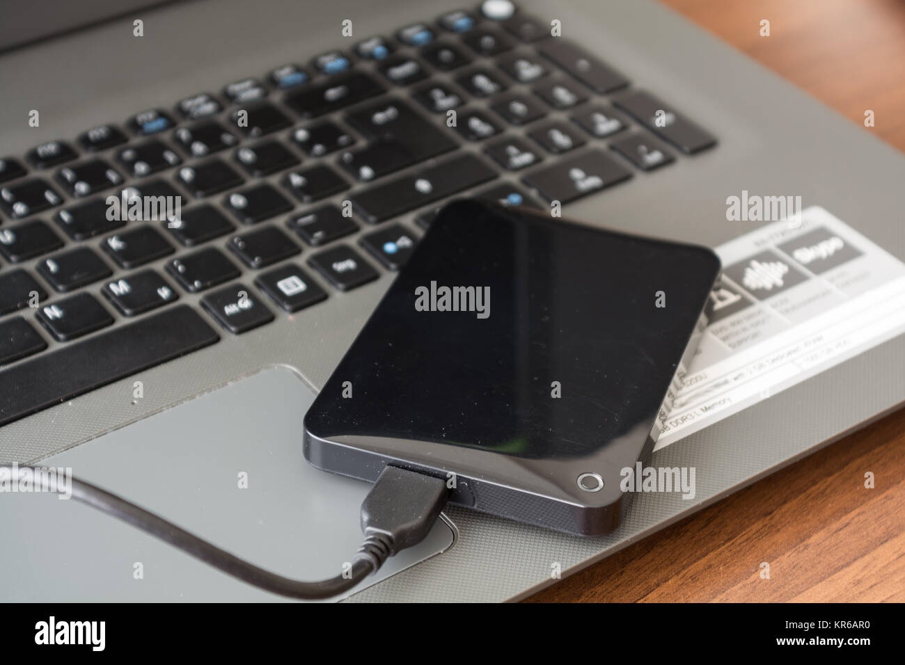 external hard drive and laptop - closeup Stock Photo