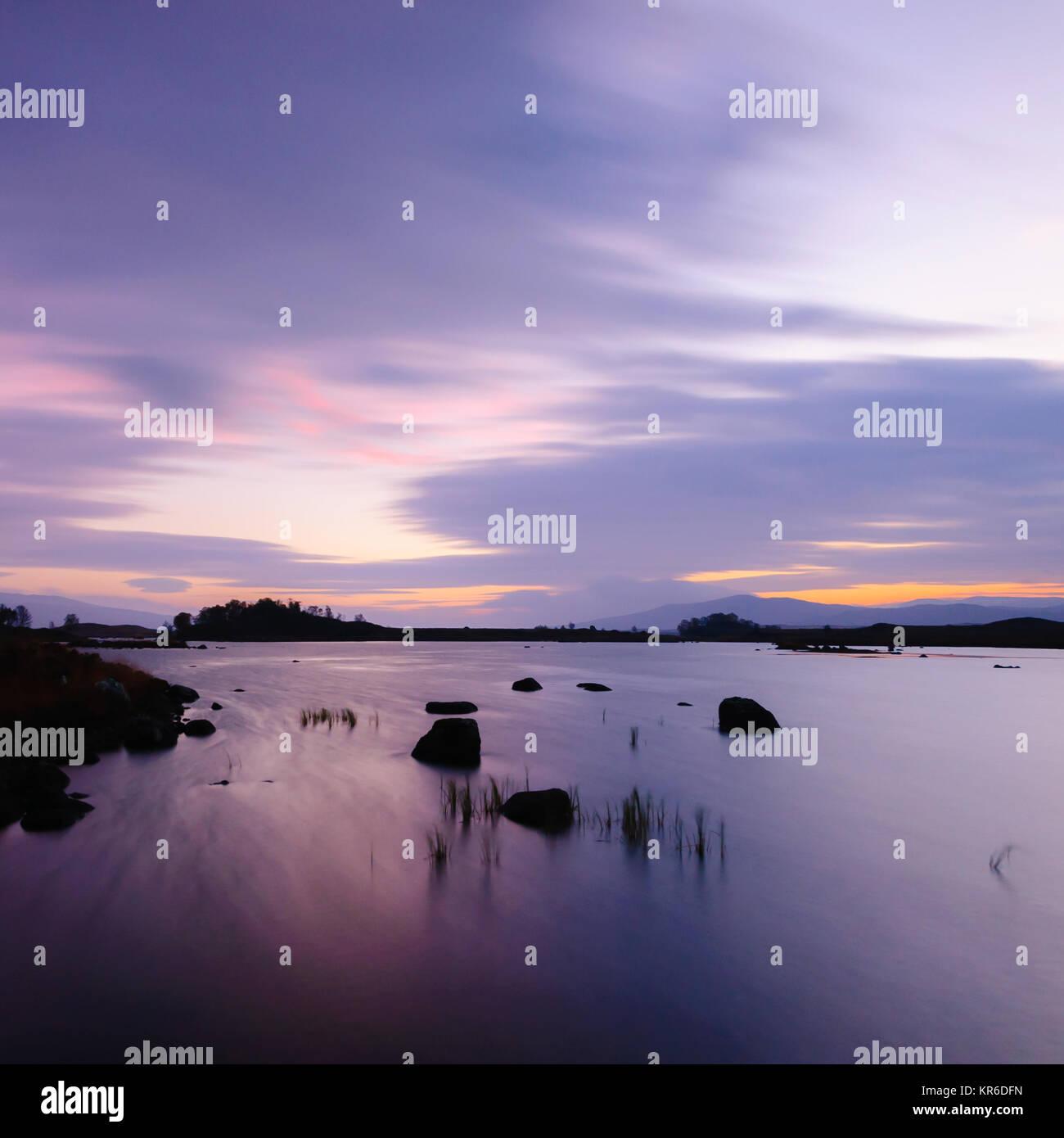 A long exposure of dawn at Loch Ba, Rannoch Moor, Highlands of Scotland - Stock Image