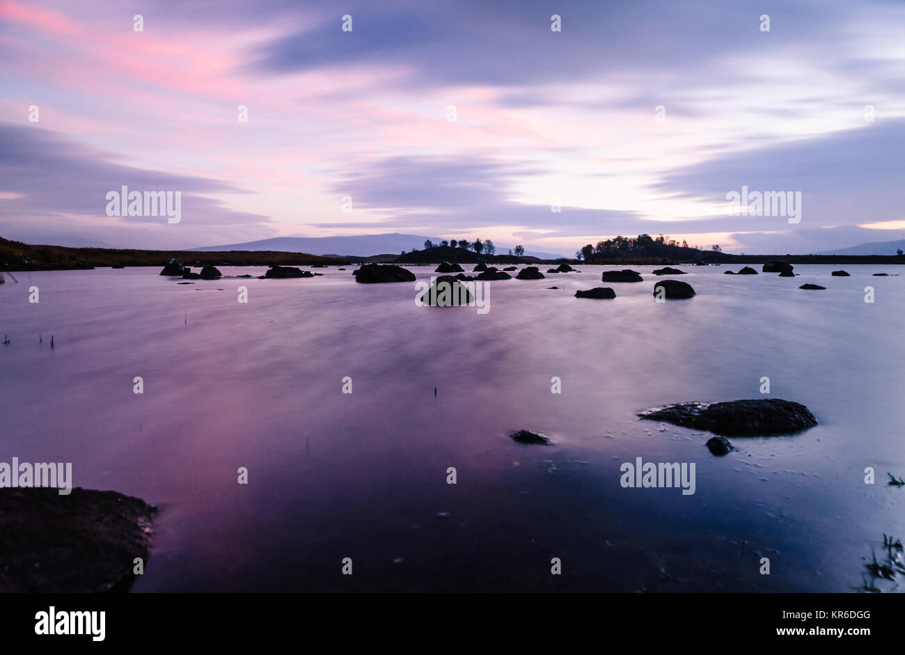 Sunrise approches at Loch Ba on Rannoch Moor in the Highlands of Scotland - Stock Image