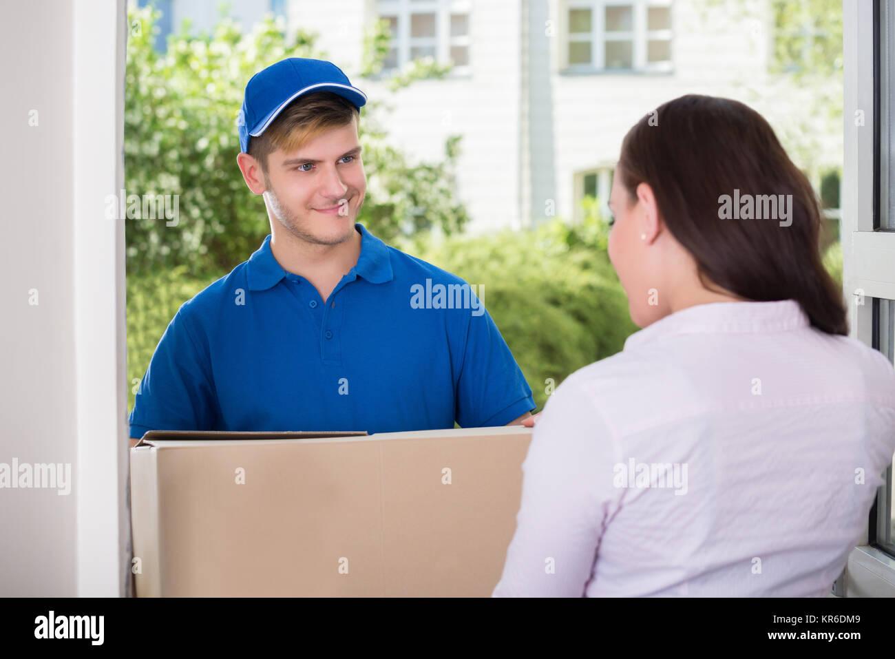 Happy Man Delivering Parcel - Stock Image