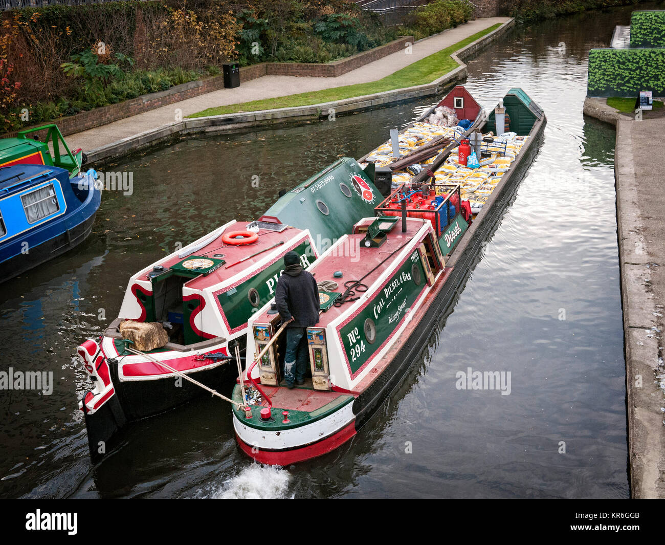 Narrow boats running in tandem on canal in Camden Town North London. - Stock Image