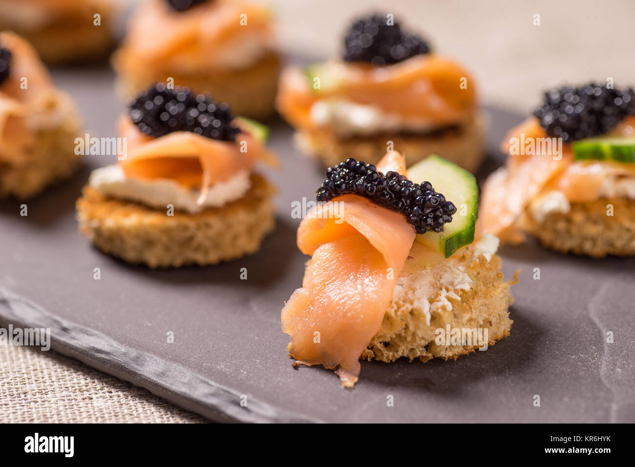 Smoked Salmon Canapes with Sour Cream and Caviar - Stock Image