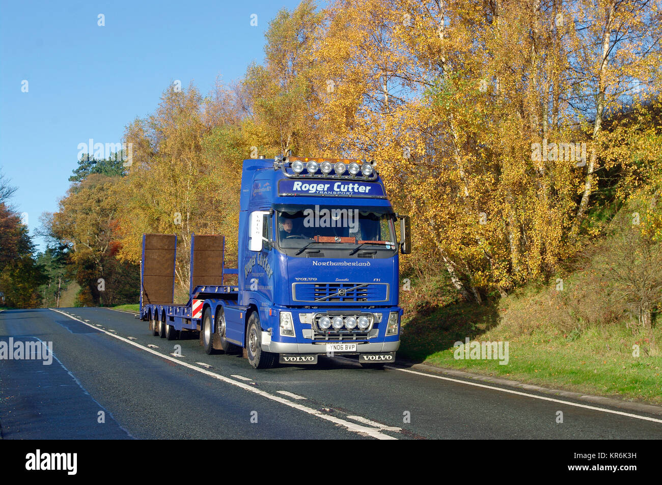 Volvo FH truck with low loader - Stock Image