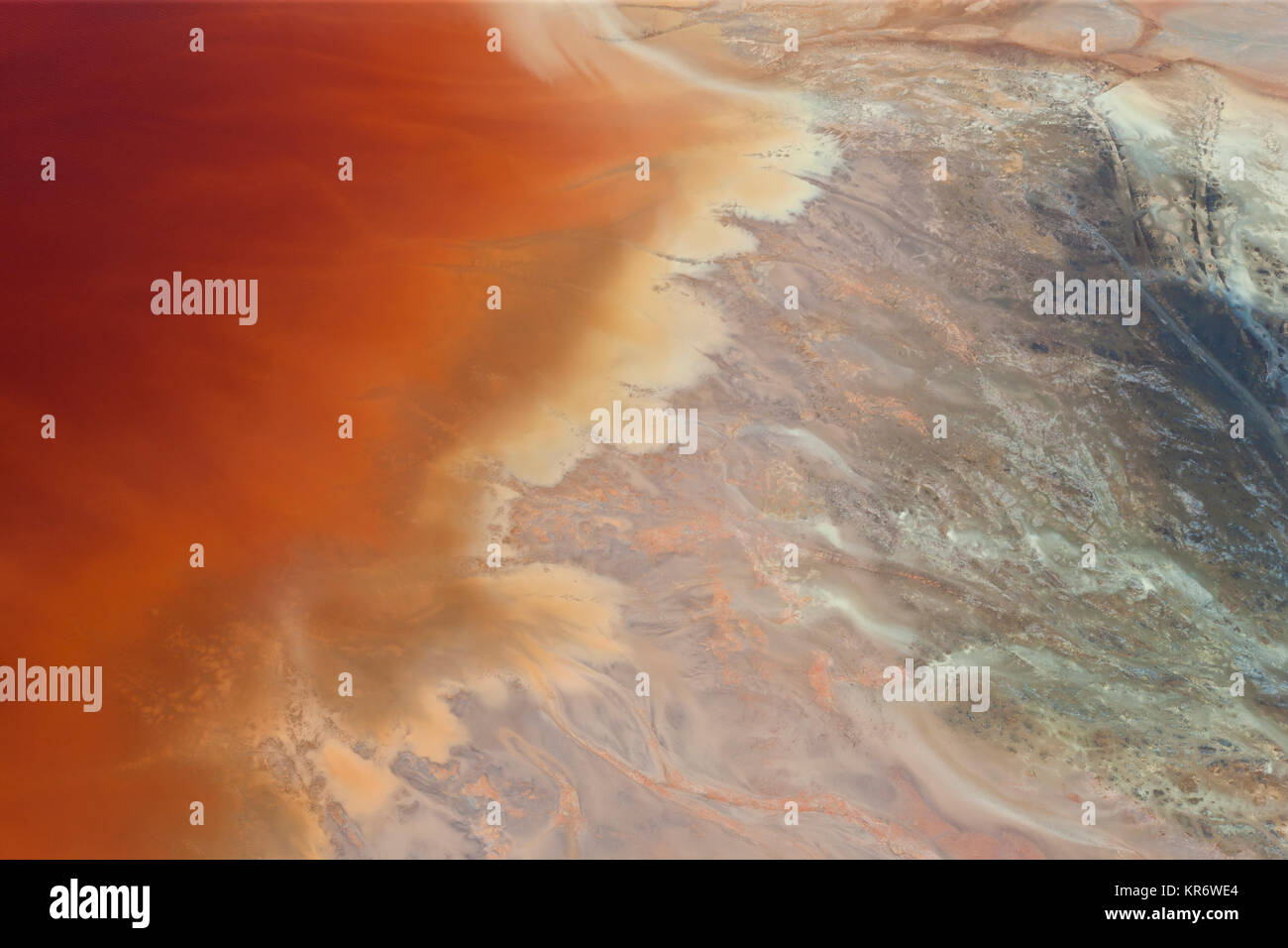 Aerial shot of oxidized iron minerals in water in old mining area. - Stock Image