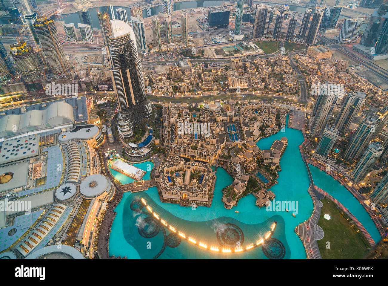 High angle view from tall skyscraper into urban area with pools and fountains. - Stock Image