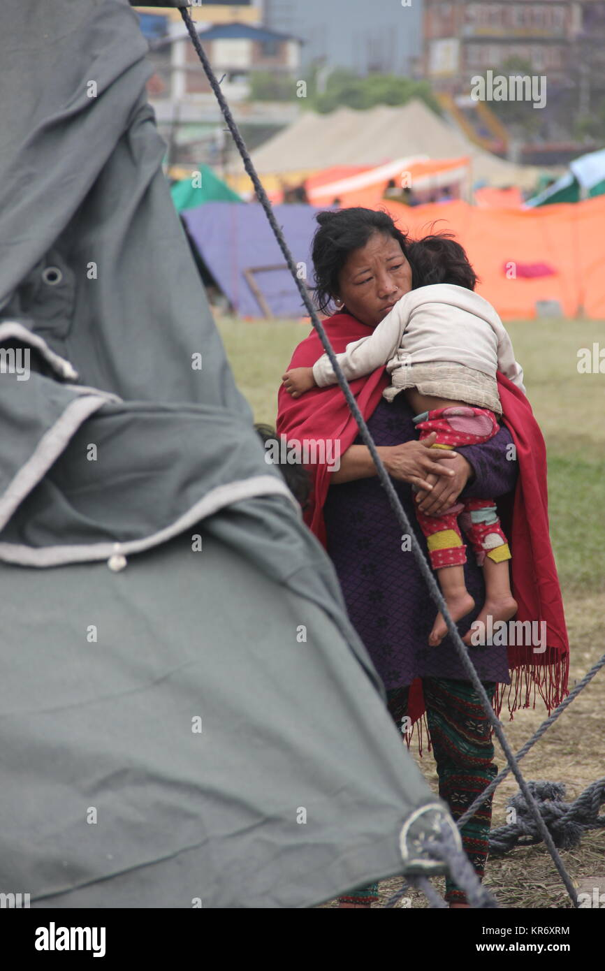 Thousands of families have been sleeping outside in makeshift camps in 2015 Earthquake in Nepal. - Stock Image