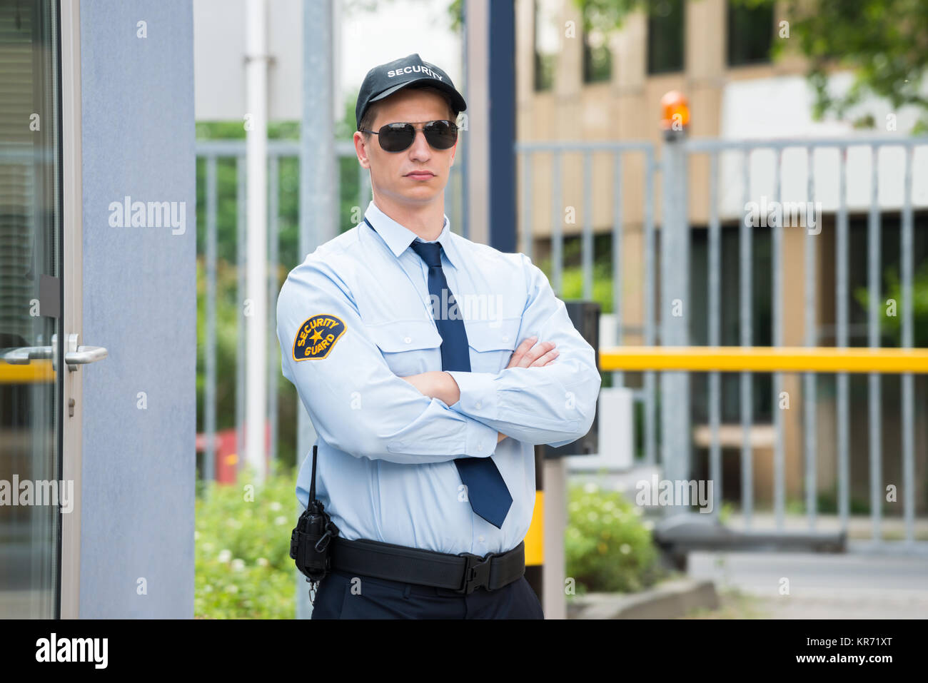Security Guard Standing Arm Crossed - Stock Image