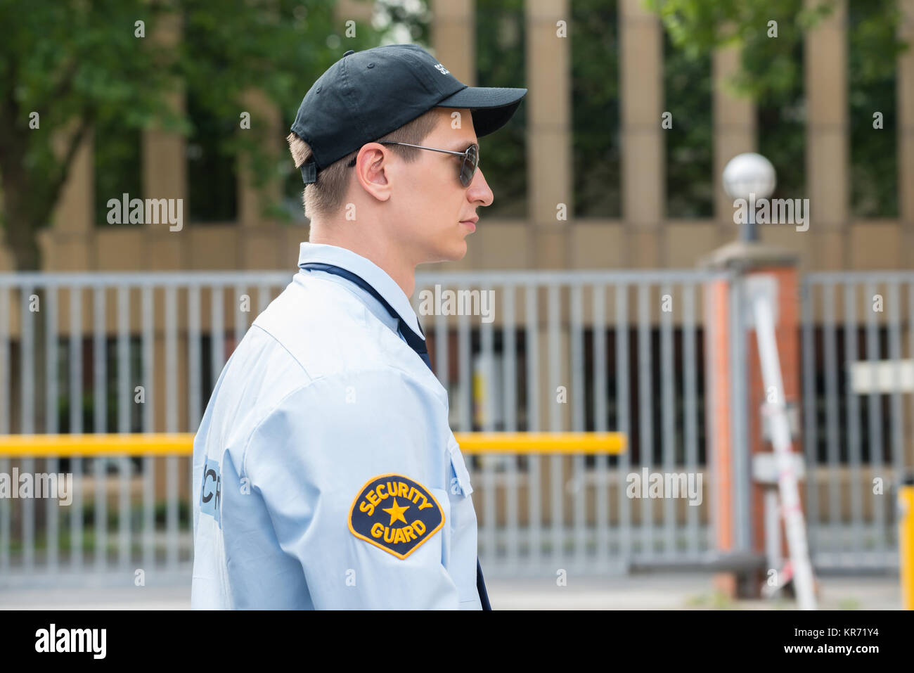 Young Male Security Guard In Uniform - Stock Image