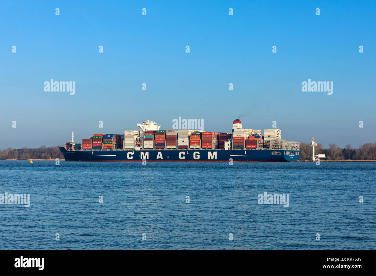 Stade, Germany - December 118, 2015: Container ship CMA CGM TANYA on Elbe river. The vessel can hold up to 9300 - Stock Image