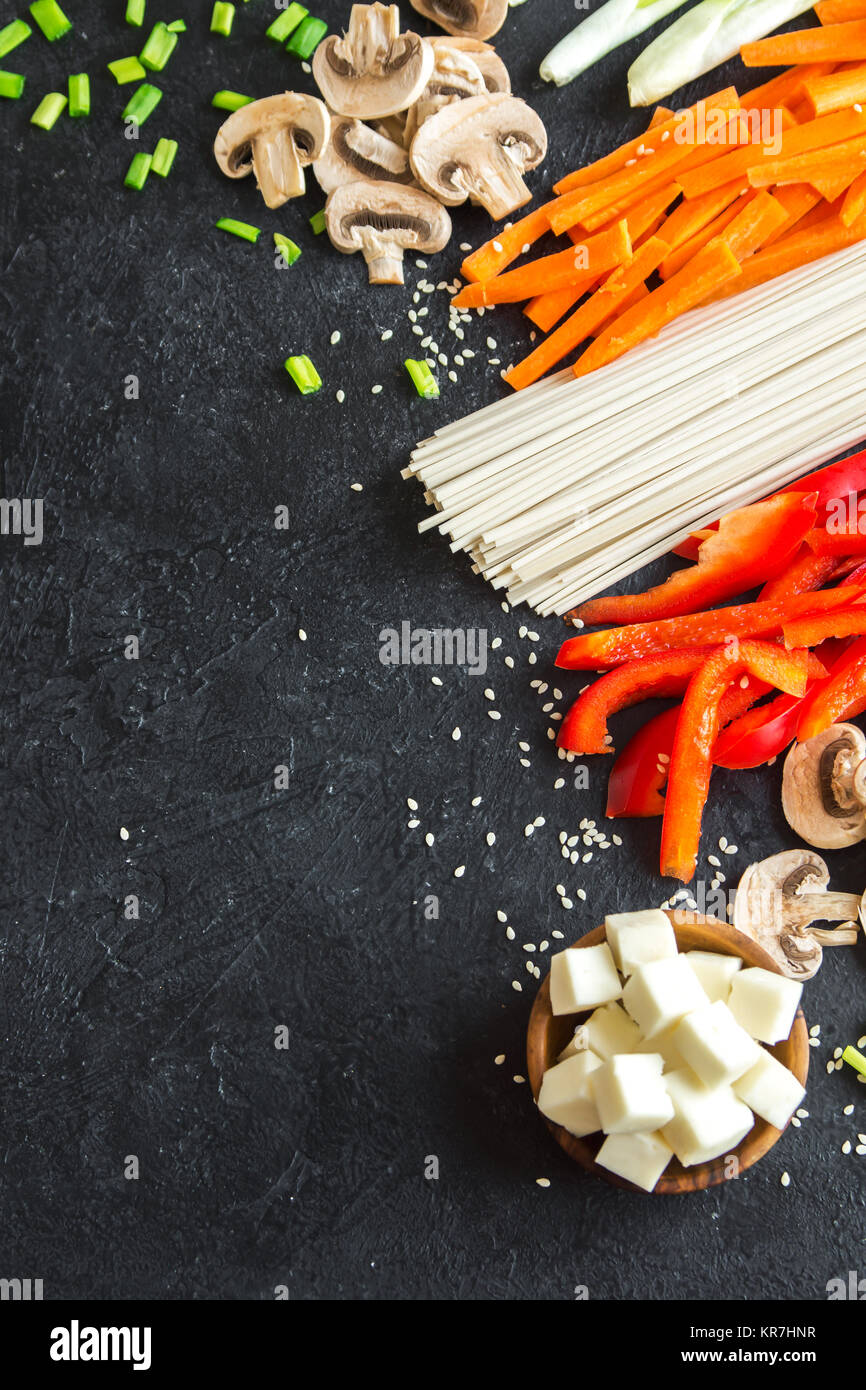 Vegetarian cooking ingredients for stir fry with tofu, noodles and vegetables. Asian vegan cuisine ingredients over Stock Photo