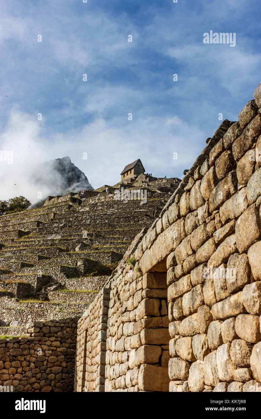 Guardian's house surrounded by clouds in Machu Picchu, Cuzco, Peru - Stock Image