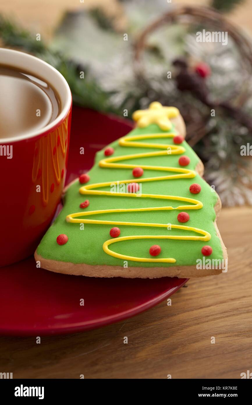 tree shape cookie and coffee cup - Stock Image