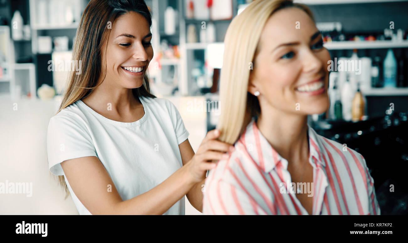 Happy woman at the hair salon - Stock Image