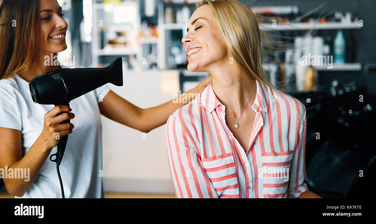 Portrait of a woman at the hair salon - Stock Image