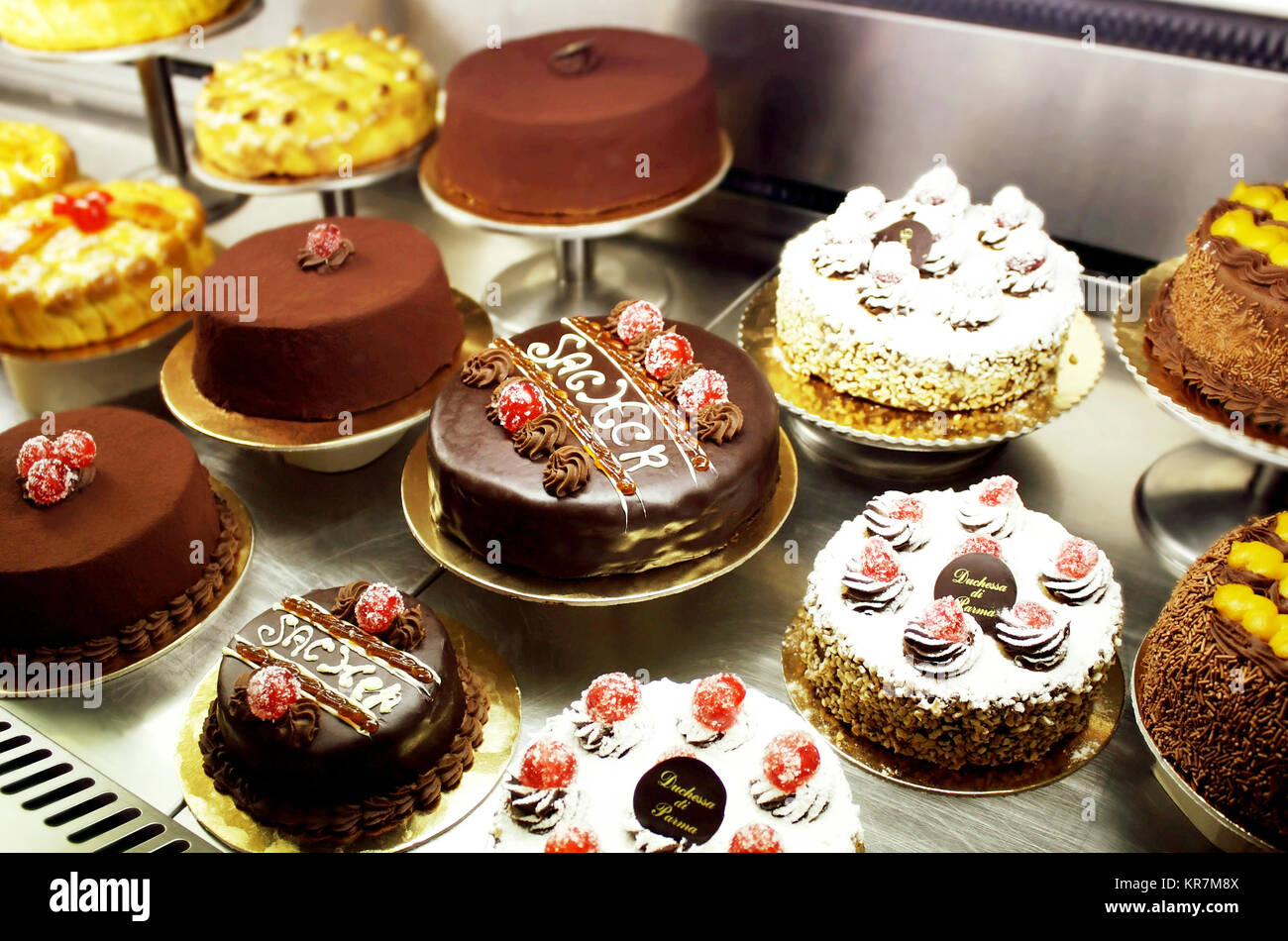 An Italian variety of different decorated cakes - Stock Image
